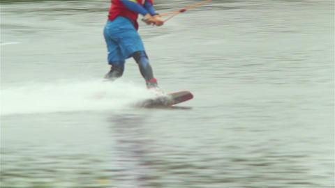 Wake board sportsman rides on water jumps trampoline, lands ok Footage
