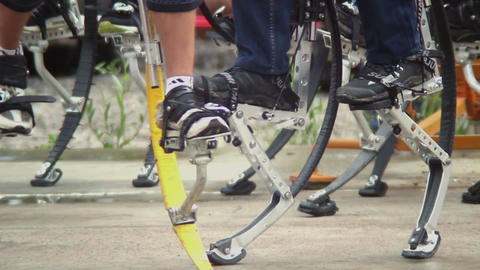 Many jumpers walk on jumping stilts, steel legs for running Footage