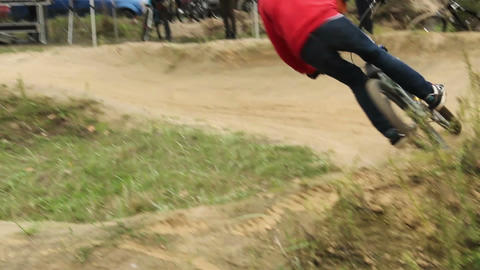 Bicycle sportsman rides bike on circuit racing contest, pedals Footage