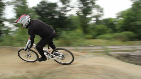 Racer rides BMX bicycle in helmet at competition circuit daytime Footage
