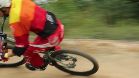 Cross-country race on BMX bicycles, man in helmet rides bike Footage