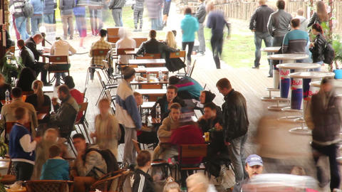 Public place cafe tables timelapse, eating people, drinking men Footage