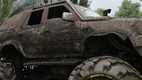 Huge big foot vehicle in dirt mud, mirrors wheels glass Live Action