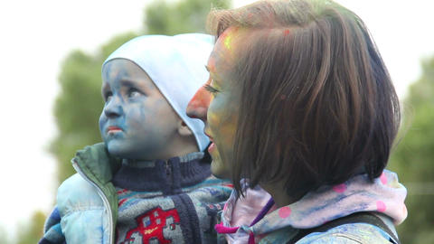 Mother and child toddler painted faces happily smile having fun Footage