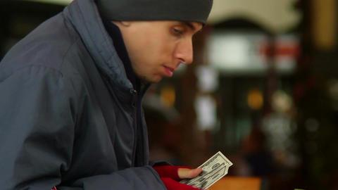 Beggar poor man counting his last money, stolen dollars, eating Footage
