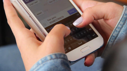 Female hands typing sms message phone no buttons, touch device Footage