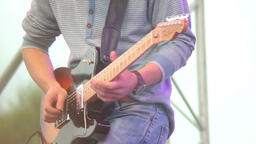 Guitar playing musician, daytime concert male guitarist on stage Footage