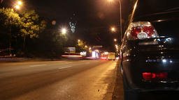 Road traffic night city timelapse, car leave red yellow traces Footage
