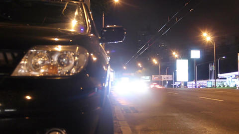 Night city traffic, cars pass by, bright lights shine timelapse Footage