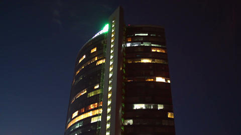 Night business center timelapse, lights turn on off offices work Live Action