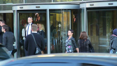 Business folk walking near business centre rotary doors, office Footage