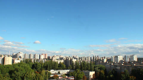 Day city timelapse, buildings houses, clouds move pass sun shine Footage