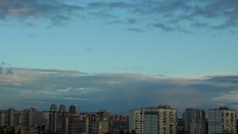 Evening city buildings timelapse, dusk houses long shadows, dawn Footage