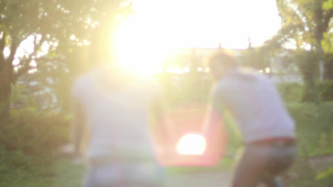 Young adult couple rides bicycles, man smiling woman romantic Footage