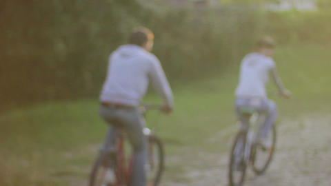 Young couple pleasure ride bicycles in park, man romantic woman Footage