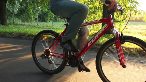 Bicycle in park, sunlight dusk riding young adult romantic ride Footage