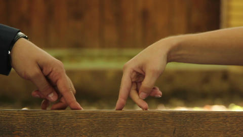 Hands walking on the bench, man and woman in love Live Action