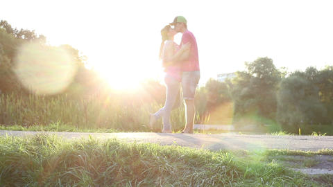 Passionate love kiss by young couple male and female Footage