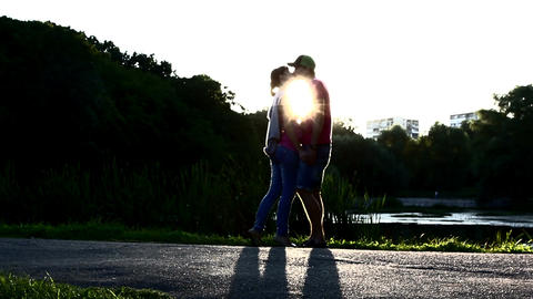 Silhouette of young couple kissing at sunset, romantic love Footage