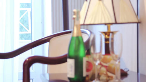 Champagne bottle with glasses in a luxury hotel room Footage