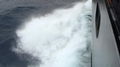 Large cruise ship at open sea. Waves splashing on the…, Live Action