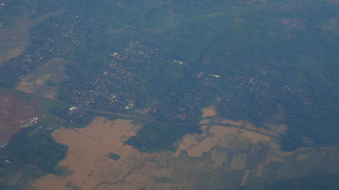 aerial view of landscape from airplane window. aerial footage of Jakarta. view settlement from the Live Action