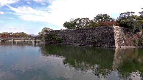 Touristic boats with tourists along the moat of Osaka Castle, Osaka, Japan. Slow Live Action