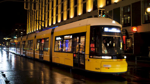 Yellow tram rides between the houses Live Action