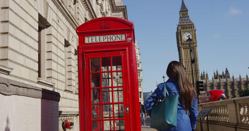 Young Urban Professional Woman By Telephone booth and Big Ben In London Live Action