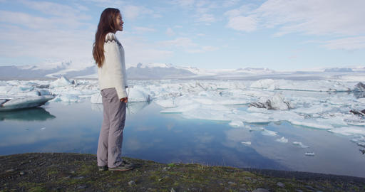 Tourist in Iceland nature landscape Jokulsarlon - Woman active lifestyle Live Action