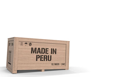 Large wooden crate with MADE IN PERU text isolated on light background. Peruvian Live Action