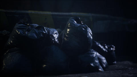 Garbage bags at city street an night Live Action