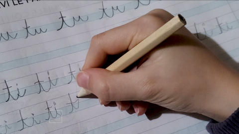 Child hand close up writing,doing primary school homework,education school 4k Live Action