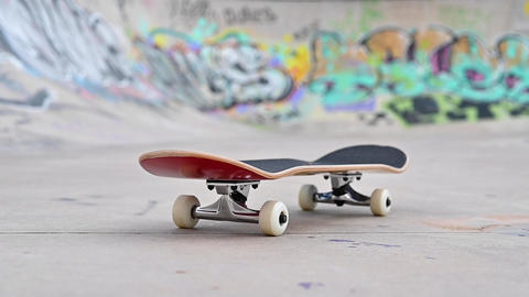 Close up of a skate board at the skate park Live Action