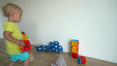 cute little boy building structure out of blocks at home. Gimbal motion Live Action