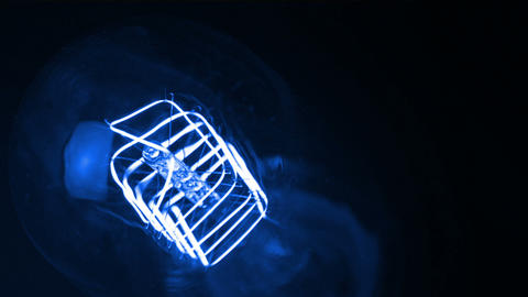 turn on and turn off, close-up of retro vintage blue light bulb with tungsten technology built-in on Live Action