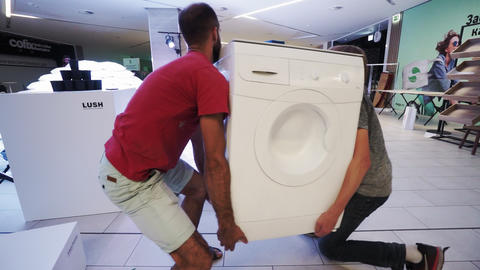 men put washing machine on stand at ecological exhibition Live Action