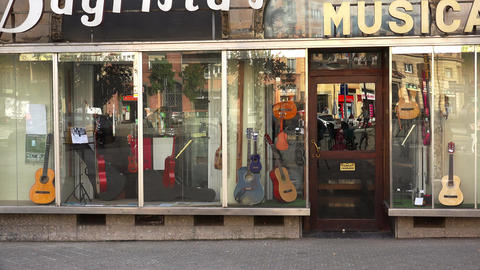 Shop musical instruments in Barcelona. Spain. 4K Live Action