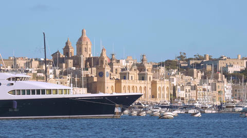 Modern and luxurious yacht in the port of Valletta - MALTA, MALTA - MARCH 5 Live Action