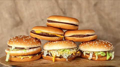 stop motion animation, stack, pile of burgers appearing, heap of fast food Live Action