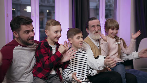 Agitated attractive fierce fans as three kids,their father and grandfather which Live Action