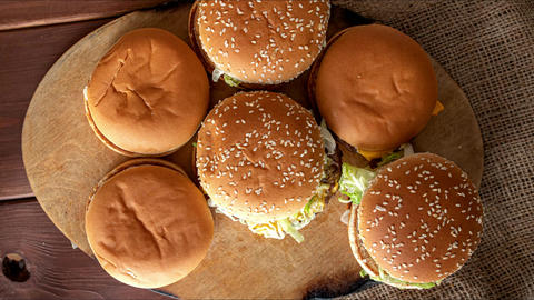 stop motion animation, burgers appearing, heap of fast food Live Action