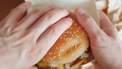 eating, biting burger from personal perspective, pov Live Action