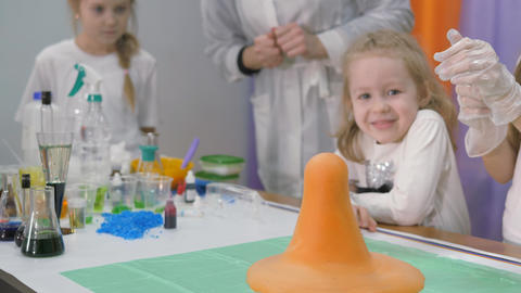 Chemical experiments for children.When you combine the ingredients, you get a red volcano. The Live Action