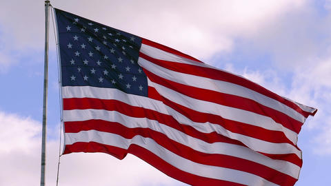 USA flag on flagpole, super slow motion video shot Live Action