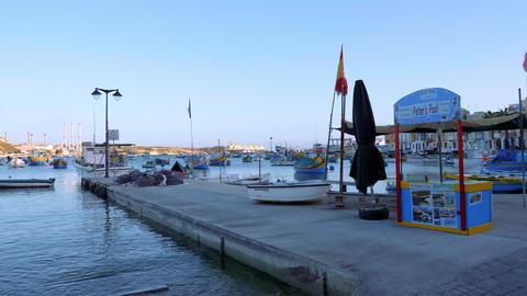 Beautiful Marsaxlokk is a popular landmark on Malta - MALTA, MALTA - MARCH 5 Live Action