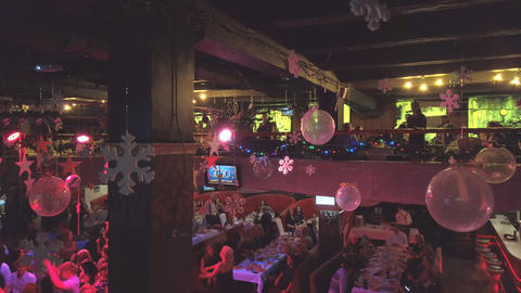 People at the holiday tables celebrate the holiday in a nightclub or restaurant Live Action