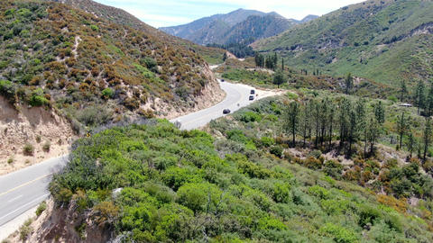 Asphalt road bends through Angeles National forests mountain, California, USA Live Action