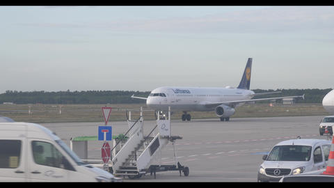 Lufthansa airplane with transportation cars and bus. Frankfurt international Live Action