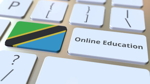 Online Education text and flag of Tanzania on the buttons on the computer Live Action